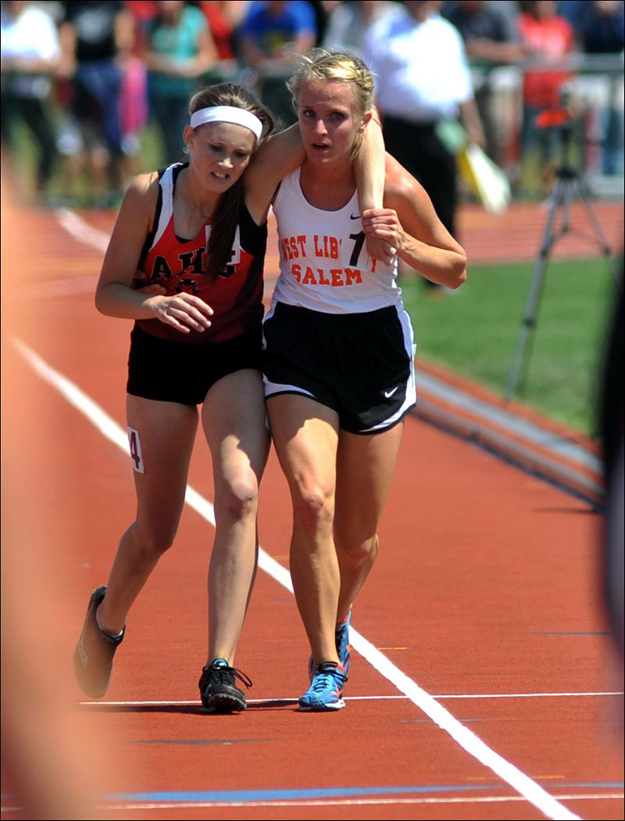 The moment in which this Ohio athlete stopped to help an injured competitor across the finish line during a track meet.